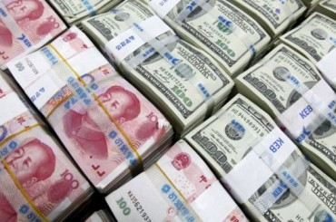 China bank chief says 'speculators' caused yuan fall